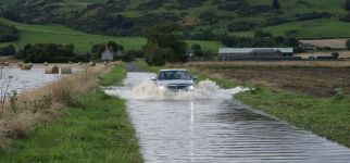 car driving through flooded road.JPG