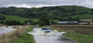 A9_Carse of G_car driving through flooded road.jpg